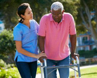 caregiver accompanying the elder man outside