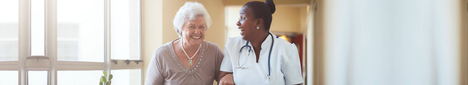 senior woman and her nurse having a good time
