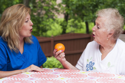caregiver and old woman having a therapy
